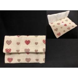 Bustina tessuto con stampa cuori e chiusura velcro.CM 11x8