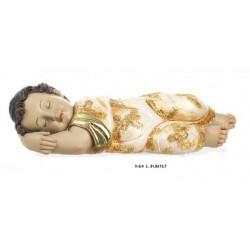 Gesu' bambino dormiente in resina. CM 32x13 H 9
