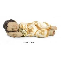 Gesu' bambino dormiente in resina. CM 20x8 H 6