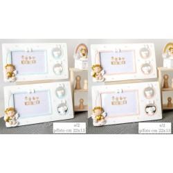 Portafoto resina con traforo laterale e angelo baby, rosa o azzurro. Ass 2 per colore. CM 22x13 EST - CM 11x7 INT