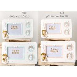 Portafoto resina con traforo laterale e angelo baby, rosa o azzurro. Ass 2 per colore. CM 15x10 EST - CM 7x5 INTERNO