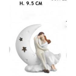 Coppia resina su mezza luna con luce LED. H 9,5