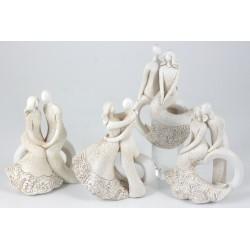 Statua sposi stilizzati in resina. Ass 4. H 16