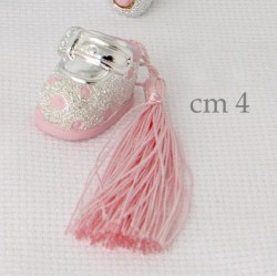 Scarpina in resina argentata con nappa rosa. CM 4